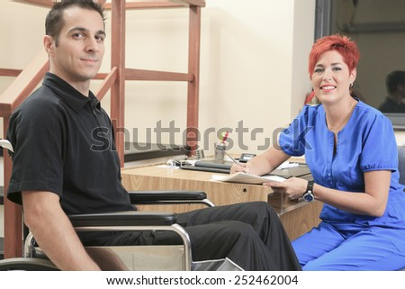 A physiotherapist woman help client at job - stock photo