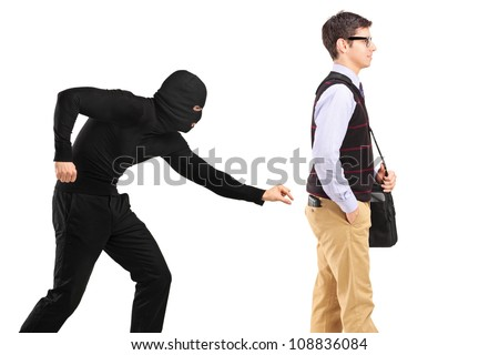 A pickpocket with mask trying to steal a wallet isolated on white background - stock photo