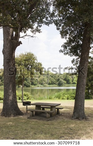 A picnic table with beautiful view lake background in Texas