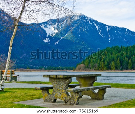 A picnic table with gorgeous view at Pitt Lake, British Columbia, Canada. - stock photo