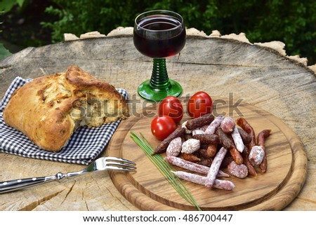 A picnic with salami and red wine