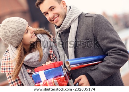 A picture of a beautiful couple on Christmas shopping - stock photo