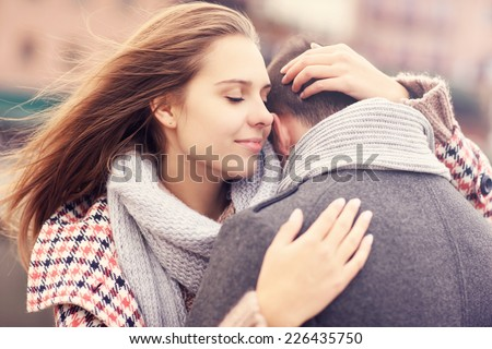 A picture of a beautiful woman comforting a man - stock photo