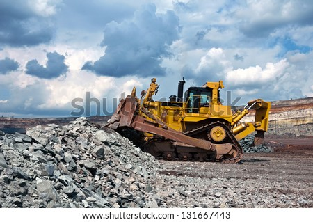 A picture of a big yellow bulldozer at work-site