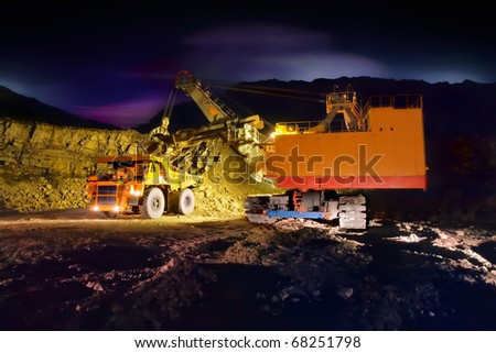 A picture of a big yellow mining truck at worksite (night) - stock photo