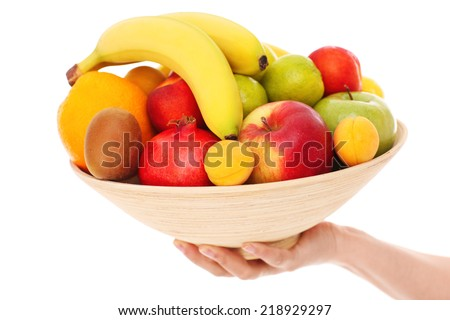 A picture of a bowl of fruits over white background