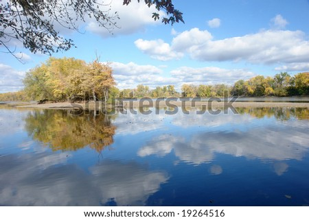 A picture of a calm Mississippi river with reflections of clouds - stock photo