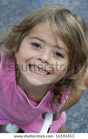a picture of a cute little girl smiling