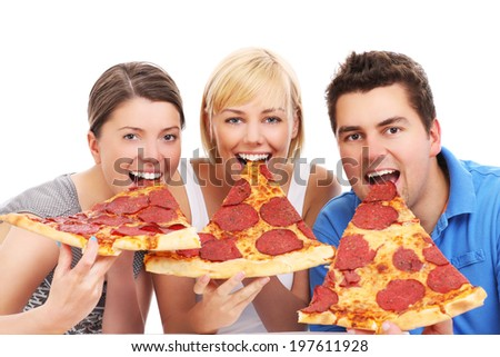 A picture of a group of friends eating big pizza slices over white background - stock photo