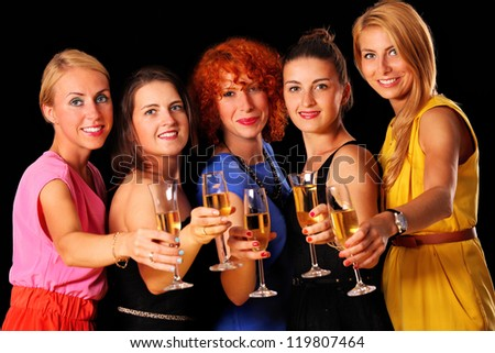A picture of a group of friends with glasses of champagne over black background - stock photo