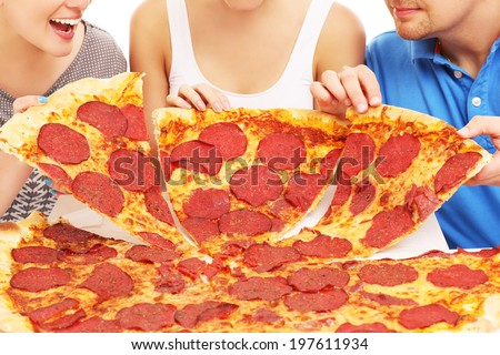 A picture of a group of friends with pizza - stock photo