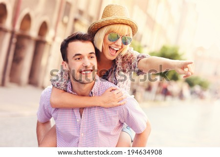 A picture of a happy couple sightseeing Gdansk in Poland - stock photo