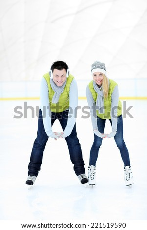 A picture of a happy woman on the ice rink