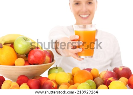 A picture of a happy woman with fruit juice over white background - stock photo