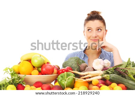 A picture of a happy woman with fruits and vegetables over white background - stock photo