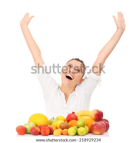 A picture of a happy woman with fruits over white background - stock photo