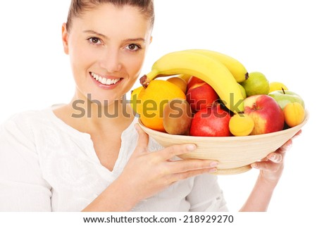 A picture of a happy woman with fruits over white background