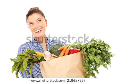 A picture of a happy woman with vegetables over white background