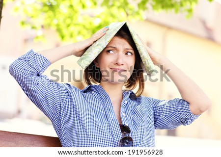 A picture of a lost tourist with a map in a town - stock photo