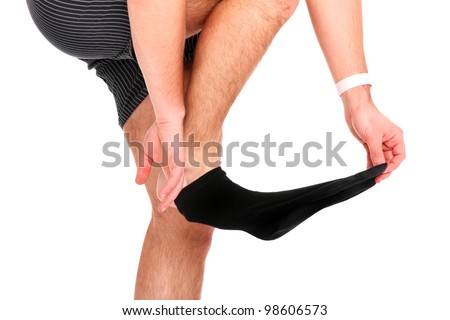 A picture of a man taking off his socks over white background