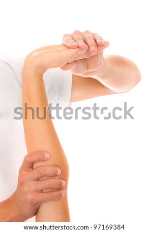 A picture of a physio therapist giving an arm massage over white background - stock photo