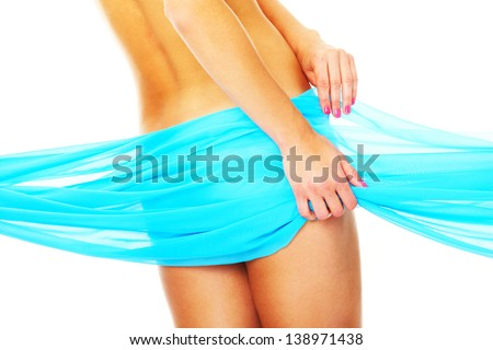 A picture of a piece of blue material covering a sensual female body - stock photo