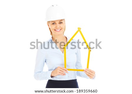 A picture of a pretty woman in a hard hat showing a house over white background