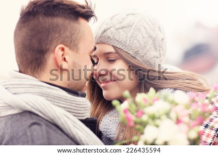 A picture of a romantic couple with flowers on an autumn walk - stock photo