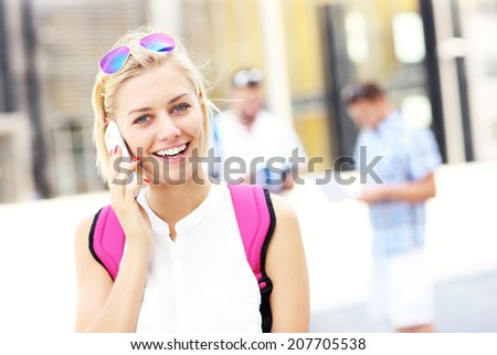 A picture of a student talking on the phone in the campus - stock photo