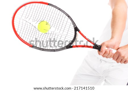 A picture of a tennis racket with broken strings