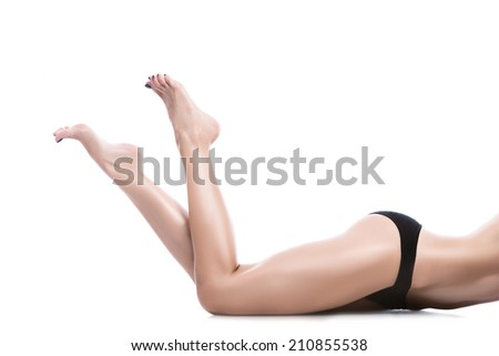 A picture of a woman lying over white background - stock photo