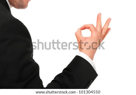 "A picture of a young businessman showing ""ok"" sign over white background - stock photo"