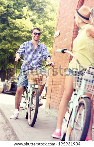 A picture of a young couple cycling in the city - stock photo