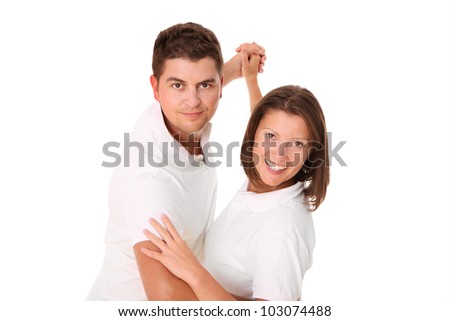 A picture of a young couple dancing over white background - stock photo
