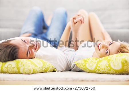 A picture of a young couple relaxing at home - stock photo