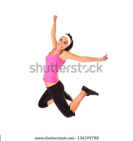 A picture of a young sporty woman jumping over white background