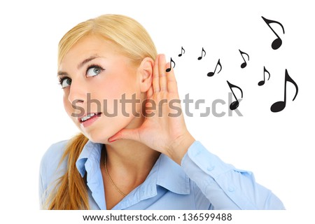A picture of a young woman listening to music notes over white background - stock photo
