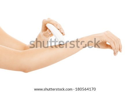 A picture of a young woman removing hair from her arms over white background - stock photo