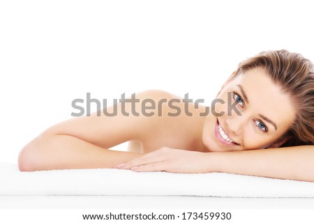 A picture of a young woman resting her head on a towel over white background - stock photo