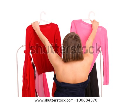 A picture of a young woman trying to pick clothes