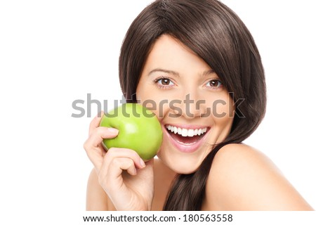 A picture of a young woman with a green apple posing over white background - stock photo