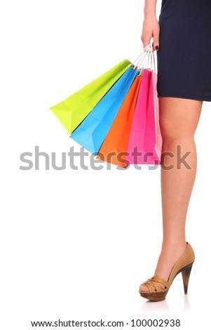A picture of a young woman with shopping bags over white background