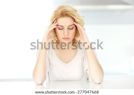 A picture of an adult woman having headache at home - stock photo