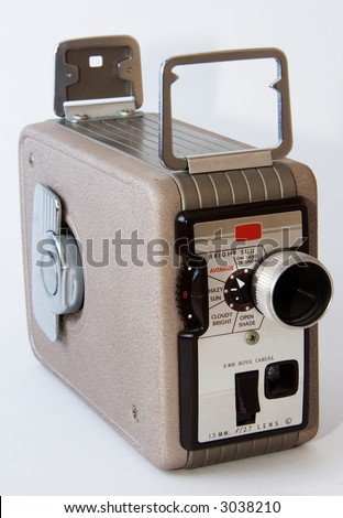 A picture of an old handheld manual movie camera