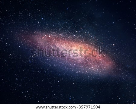 A picture of bright spiral galaxy with myriads of stars - stock photo