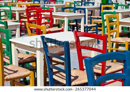 A picture of colorful chairs outside a restaurant