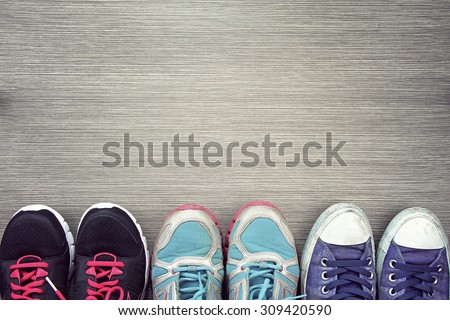 A picture of different shoes, Shot of several types of shoes, Several designs of men's and women shoes. Leather Shoe, Sport Shoe. - stock photo