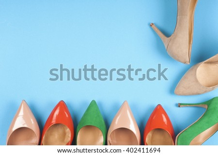 A picture of different shoes, Shot of several types of shoes, Several designs of  women shoes. Leather Shoe. Pile of various female shoes on on  light  background - stock photo