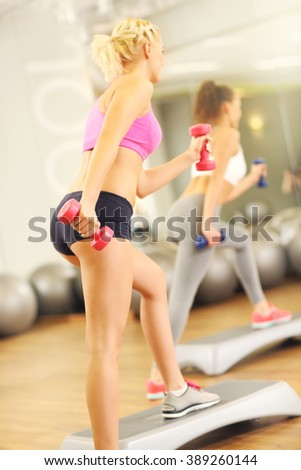 A picture of female group working out in gym
