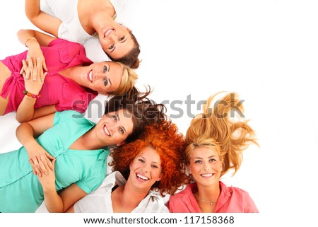 A picture of five women standing in a row in colorful shirts and smiling over white background - stock photo